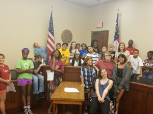Peacebuilders campers with Marilyn Primovic at the Sumter County courthouse