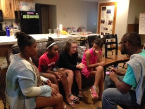 Campers Cate, Carmen, Violet, and Farzana discuss with Mario how King approached social change