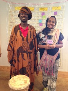 Elysee and Iesha try on some Liberian clothes
