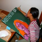 Mani works on her portrait
